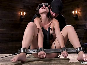 black-haired fuckslut in metal stock cooch tormented