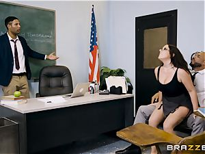teacher Angela milky filled nut sack deep in her classroom
