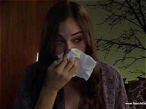 magnificent Sasha Grey bares her small bra-stuffers